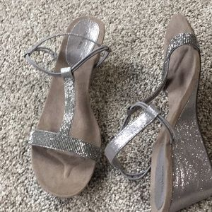 Never worn!  Silver t strap shoes